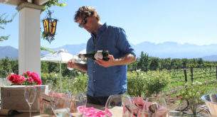 Henk van Niekerk pours a glass of MCC on the stoep of his home near Robertson. Photo: Christi Nortier.