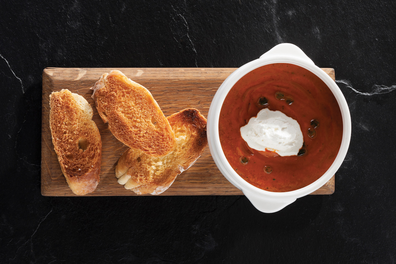 Warm up this winter with The Hussar Grill's legendary tomato soup