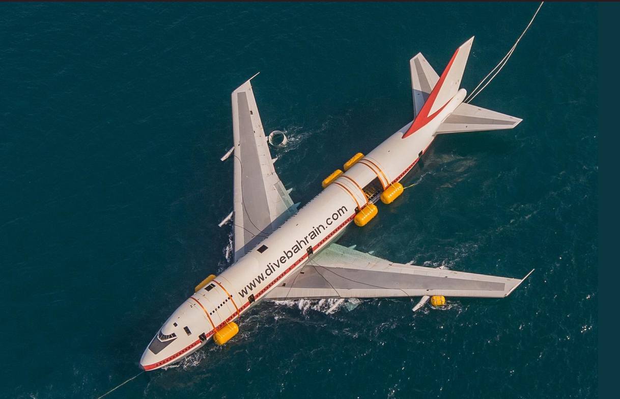 Boeing 747 get towed out to sea