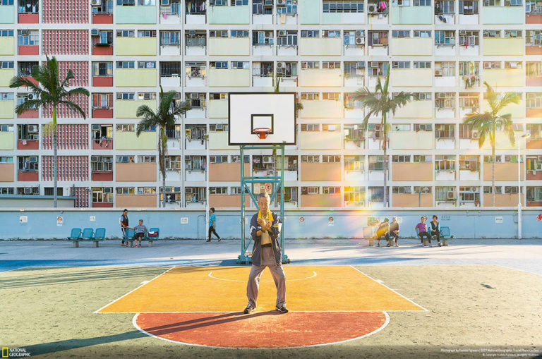 Second place, people. Yoshiki Fujiwara says: 'This photo was taken at a public park at Choi Hung House in Hong Kong. When I visited during the afternoon, it was very crowded with many young people taking pictures and playing basketball. But when I visited at sunrise, it was quiet and a different place. [The area] is [designated] for neighborhood residents in the early morning, and there was a sacred atmosphere. I felt divinity when I saw an old man doing tai chi in the sun.'