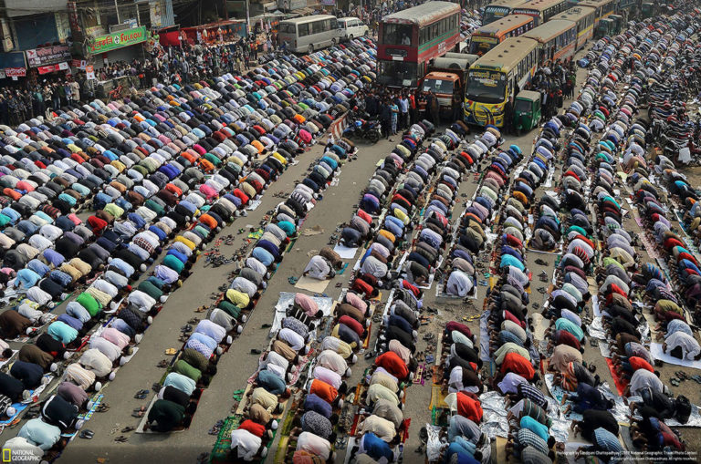 Third place, cities. Sandipani Chattopadhyay says: 'People pray on the street in Dhaka, Bangladesh during Ijtema. Bishwa Ijtema is one of the major Islamic religious gatherings which is [observed] annually in Dhaka and millions of Muslims visit [during this time]. Dedicated prayer grounds are not [large] enough to handle this huge number of people, so large numbers of people come to [Tongi], the main street of Dhaka. All the ground transportation and [pedestrian crossings] are suspended during that time.'