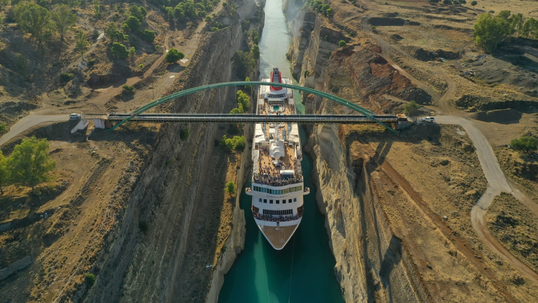 Cruise ship squeezes through Greek canal to claim record