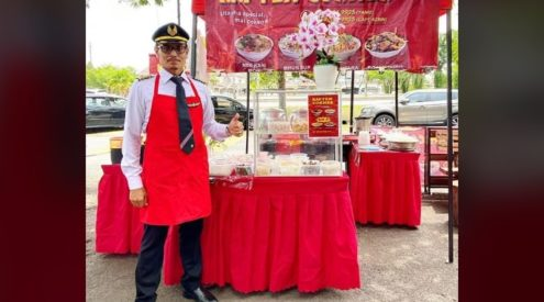 Retrenched airplane pilot opens Malaysian food stand