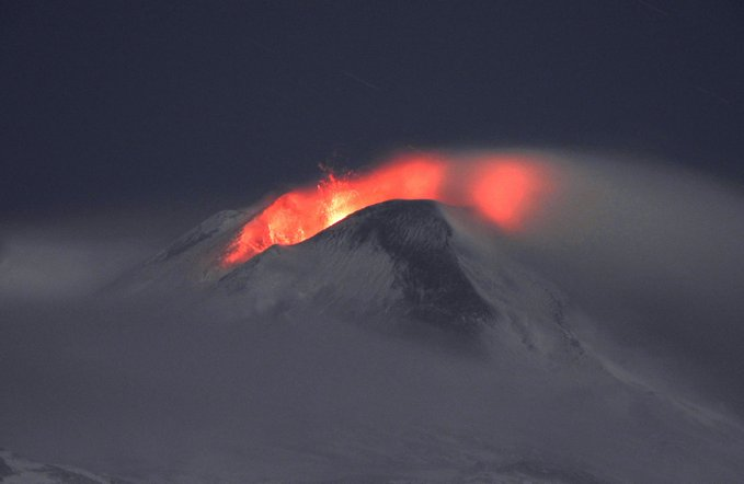 Mount Etna erupts in a plume of smoke and lava
