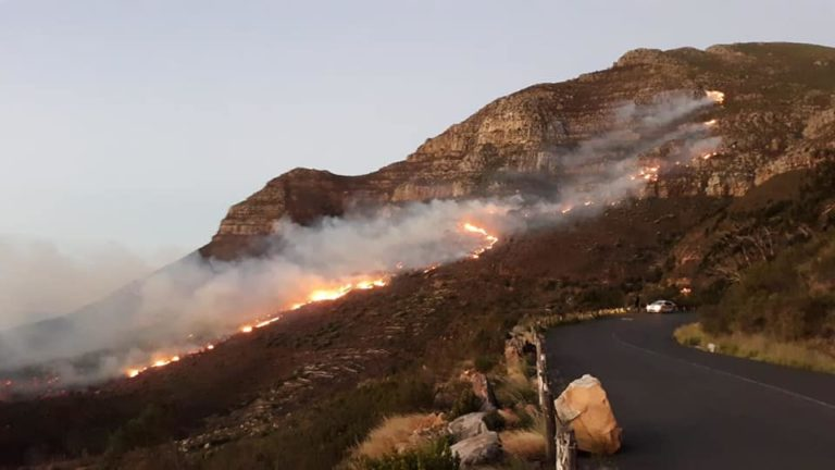 Cape Town fire largely contained, but firefighters still labour on